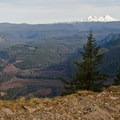 The view from the eastern end of Castle Rock includes Mount Washington (7,795'), the upper McKenzie Valley, and Three Sisters (10,358').- King Castle to Castle Rock Trail