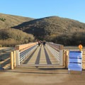 Visitors follow a boardwalk en route to Muir Beach.- Muir Beach