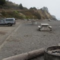 Picnic areas and fire pits along Van Damme Beach. - Van Damme State Park
