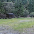 Day use area adjacent to the Smith River at Panther Flat Campground.- Panther Flat Campground