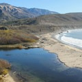 Looking south at the Big Sur River Estuary and Andrew Molera State Beach near Molera Point. The ridge trail can be seen in the distance.- Headlands Trail