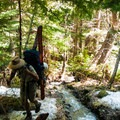 Reaching snow after 5 miles.- Royal Basin Backcountry Ski Tour