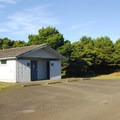 Westside restroom and shower facility in Twin Harbors State Park Campground.- Twin Harbors State Park