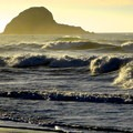Golden sunlight through ocean spray at Trinidad State Beach.- Trinidad State Beach