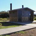 Vault toilets in Kirk Creek Campground.- Kirk Creek Campground
