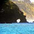 The natural arch at College Cove Beach.- College Cove Beach
