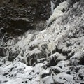 Ice fed by a spring in the cliffside.- Outlet Falls