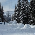 Building snow shelters in the day use area.- Skyline Lake