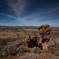 Smith Rock State Park: View of Monkey Face and the Cascade Mountains.- Smith Rock State Park