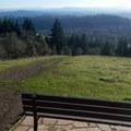 This is one of several benches perched at the best viewpoints in Chip Ross Park.- Dimple Hill