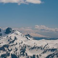 Looking south at the Tatoosh Range and Mount Adams (12,281') in the distance.- Edith Creek Basin