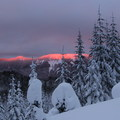 The mountainside showcasing some alpenglow from the sunset.- Barlow Ridge Hut