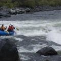 A paddle raft drops into Granite.- Snake River