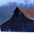 A barn on site provides a scenic backdrop.- The Rolling Huts