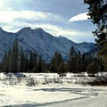 Mountains in the distance along the Icicle River Trails.- Icicle River Trails