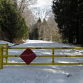 Closed winter gate at the trailhead.- Big Four Ice Caves