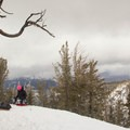 Getting set for a powder run on the summit of Powderhouse Peak.- Powderhouse Peak