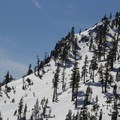 Jake's east aspect has enticing terrain but is also more slide prone than the glades to the north. Small trees and open areas mark the avalanche paths.- Jake's Peak