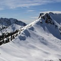 Mount Diller's east ridge provides the most direct route to the summit. Brokeoff Mountain (9,235') rises in the distance.- Mount Diller Backcountry Ski: Southwest Chute