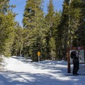 An information kiosk marks the beginning of the skin track and cross-country ski and snowshoe trail that heads to Castle Pass.  - Castle Peak
