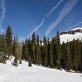 Castle Peak's south aspect rises above the approach trail. - Castle Peak