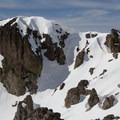 Mountaineering courses are held regularly below Castle Peak.- Castle Peak
