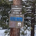 Signage at the trailhead noting the difficulty rating.- Pipe Creek