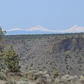 The Three Sisters and Broken Top from the Crooked River Canyon.- Chimney Rock Trail