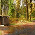Vault toilet facility in Queets Campground.- Queets Campground