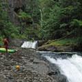 The team regroups at the lip of 80-foot Final Falls.- Salmon River Canyon