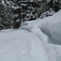 A thick snow bank along the way.- Grace and Summit Lakes