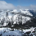Summit view to the north with the ski area and Highway 2 below and the Glacier Peak Wilderness beyond.- Cowboy Mountain