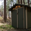 Typical vault toilet in Cold Springs Campground.- Cold Springs Campground