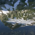 Alpine Peak reflected in Alpine Lake.- Alpine + Sawtooth Lakes, Iron Creek Drainage