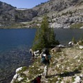 Skirting the shores of Lake 9167, also known as North Alpine Lake.- Alpine Creek Canyon