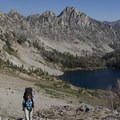 Climbing to the pass with the Flytrip Lake Basin above North Alpine Lake.- Alpine Creek Canyon