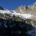 Alpine Peak (9,861') viewed from the south shore of Alpine Lake.- Alpine + Sawtooth Lakes, Iron Creek Drainage