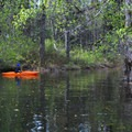 Zach Urness in his kayak on the lake taking in the magic of the area.- Disappearing Lake