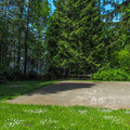 The basketball court in the community area.- Birch Bay State Park Campground