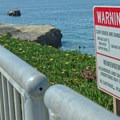 Signs cautioning visitors.- Lighthouse Field State Beach