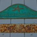 The dedication on the door of the lighthouse on Seabright Beach.- Seabright Beach