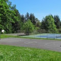 The basketball and tennis courts at the east end of Discovery Park.- Discovery Park + Fort Lawton Historic Area