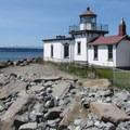 The West Point Lighthouse stands at Seattle's western tip.- Discovery Park + Fort Lawton Historic Area