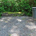 Potable water and waste and recycle facilities near the playfield loop.- Bay View State Park Campground