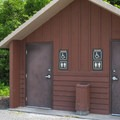 Vault toilets in the day use parking lot.- Bay View State Park