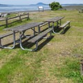 A day use picnic area and fire circle.- Bay View State Park