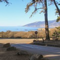 View from the campground entrance looking north up the Big Sur coastline.- Plaskett Creek Campground