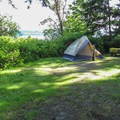 A standard tent campsite with views.- Camano Island State Park Campground