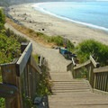 Access to the beach is down a few stairs.- New Brighton State Beach