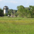 The Tennant Lake Park tower from the River Dike Trail.- River Dike Trail